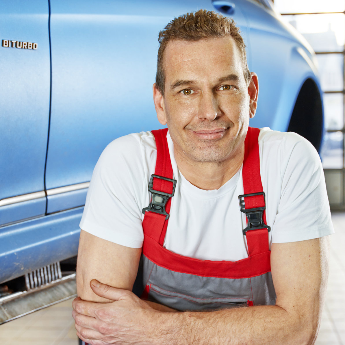 Master mechanic in a garage